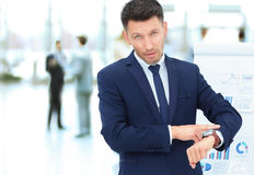 Concept - take care of your time. businessman points to his watc Royalty Free Stock Photo