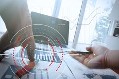 Concept of target focus digital diagram,graph interfaces,virtual UI screen,connections netwoork.Hipster finance analist working w. Ith laptop at trendy office royalty free stock photo