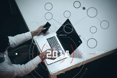 Concept of target focus digital diagram,graph interfaces,virtual UI screen,connections netwoork.Hipster finance analist working. At trendy office royalty free stock photos
