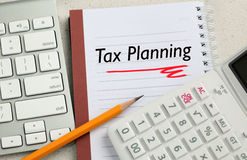 Concept of tax planning. Tax planning concept, with calculator and desk background stock photos