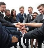 Large group of business people standing with folded hands together Royalty Free Stock Photo