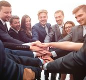 Large group of business people standing with folded hands together. Concept of team building. large group of business people standing with folded hands together Royalty Free Stock Photo