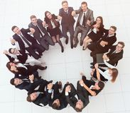 Concept of team building .large successful business team sitting in a circle stock image