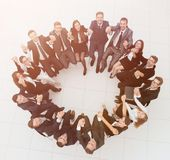 Concept of team building .large successful business team sitting in a circle Royalty Free Stock Image