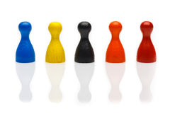 Concept: team, social, diversity, ethnicity, culture. Concept: team, social, diversity, ethnicity, culture. Several colored pawn figures isolated on white Stock Image