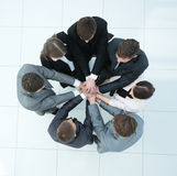 Concept of the team .standing in a circle of friendly business t Stock Photos