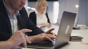 Man using internet on laptop computer sitting in office stock footage