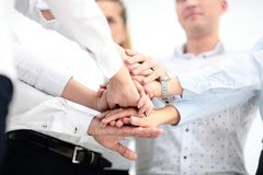 Concept of teamwork. business people joined hands. In office Stock Image