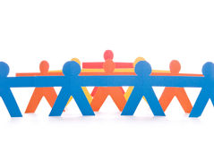 Concept of teamwork, colorful paper dolls Royalty Free Stock Photo