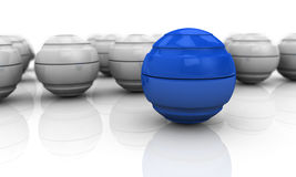 Concept of teamwork and leader. Close up of a blue sphere with others in background (3d render Royalty Free Stock Image