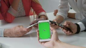 Concept of teamwork main focus on left phones. Phone with greenscreen 4k 20s 30s. Concept of teamwork main focus on left phones. Phone with greenscreen. 4k 20s stock footage