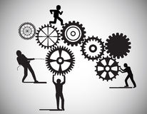 Concept of Teamwork, people building gear wheels, this also represents business partnership, unity, team working . Stock Photography