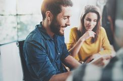 Concept of teamwork process at office.Smiling Coworkers meeting.Blurred background.Horizontal. Royalty Free Stock Image