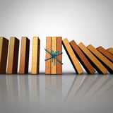Concept Of Teamwork. And strong partnership stability strategy as a group of domino pieces tied together to stop the fall damage crisis as a business metaphor Royalty Free Stock Images