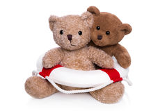 Concept teamwork - teddy bears with lifebelt. Stock Photos