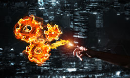 Concept of teamworking or organization presented by fire glowing cogwheels Stock Images