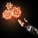 Concept of teamworking or organization presented by fire glowing Stock Photos