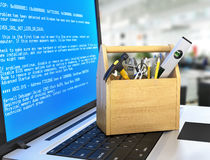 Concept of  technical service and repair computer. Wooden box wi. Th tools at the keyboard notebook on a blurred background. Technical support Royalty Free Stock Photo