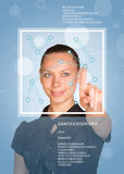 Concept of technology. Beautiful brunette in dress pointing finger on virtual grid Stock Images