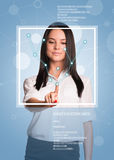 Concept of technology. Beautiful brunette pointing finger on virtual grid. Frame and text. Blue background Royalty Free Stock Images