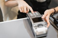 Concept of technology in buying without using cash. Stock Image