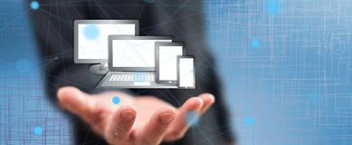 Concept of technology devices. Technology devices concept above the hand of a man in background stock image