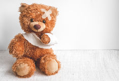 Concept teddy bear childhood diseases at textile background. Close up Stock Images