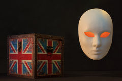 Concept of terrorism.England flag box and mask Royalty Free Stock Photo