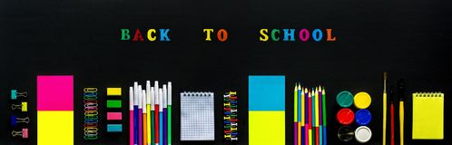 Concept Text Back to school, stationery supplies on black chalkboard background. Design Top View Flat Lay Banner stock image