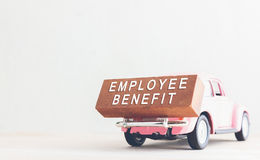 Concept is text employee benefits on the wood with car. Royalty Free Stock Images