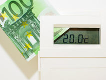 Concept thermostat and banknote for heating expensive Royalty Free Stock Photo
