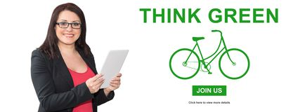 Concept of think green. Woman using digital tablet with think green concept on background royalty free stock image