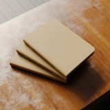 Concept of three blank notebook with brown craft paper cover on wooden desk. Empty horizontal mockup. 3d rendering Stock Image