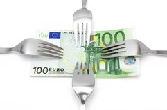 Concept of tight budget with banknote and fork.  Royalty Free Stock Photo