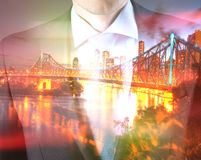 Concept of time with businessman and city Stock Photo