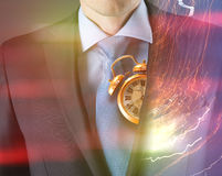 Concept of time with businessman and clock Stock Photo