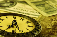 Concept Time is money stylized as antique Stock Image