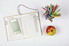 Concept of time planning, notepad, blank page, phone, colored pencils and pens. apple. planning, school schedule. new idea. top vi. Concept of time planning Stock Photos