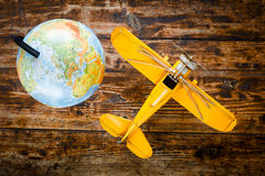 Concept - time to travel plane, globe Stock Image