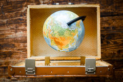 Concept - time to travel suitcase, globe Stock Photos