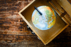 Concept - time to travel suitcase, globe Royalty Free Stock Image