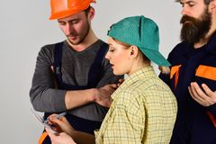 From concept to creation. Men and woman builders working in team. Construction workers team. Group of constructing. From concept to creation. Men and women stock photo