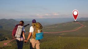 Concept toeristenpaar met GPS-Pictogrammen royalty-vrije stock afbeeldingen