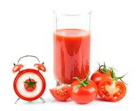 Concept with tomato juice, red clock and tomato. Isolated on white background Royalty Free Stock Photography