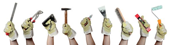 Concept of tools in hands with gloves Stock Photography