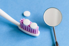 Concept tooth pain - dentist tools, tablet at blue background Stock Image