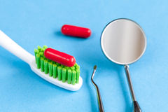 Concept tooth pain - dentist tools, tablet at blue background Stock Images