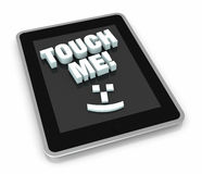 Concept of touch technology. Top view of a tablet pc with the phrase: touch me and a smile symbol. Ironic way to show the new touch technologies (3d render Stock Photography