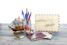 The concept of tourism by water transport. The concept of tourism and travel by water transport. Passport, money, coins, seashells, and a toy ship on a wooden Royalty Free Stock Photos