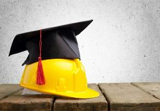 Concept of tradesman building. Construction education academic apprentice apprenticeship black Stock Photos